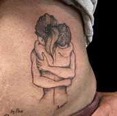 single needle hugging couple tattoo maximum colour