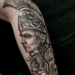 Athena black and grey forearm tattoo