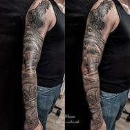 Realistic nautical black and grey sleeve tattoo