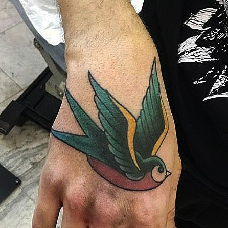 Traditional swallow hand tattoo