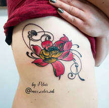 Lotus ribcage tattoo
