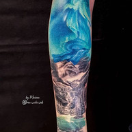 tattoo nothern lights forearm landscape realism