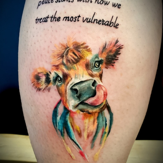 watercolor cow tattoo