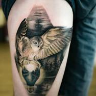 Colour realistic owl thigh tattoo