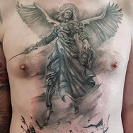 Archangel Michael chest black and grey tattoo