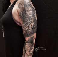 Moon phases realistic portrait black and grey sleeve tattoo