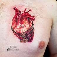 Realistic heart color tattoo