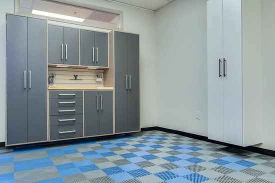 Custom cabinets with a rubber tile floor from Designer Garages