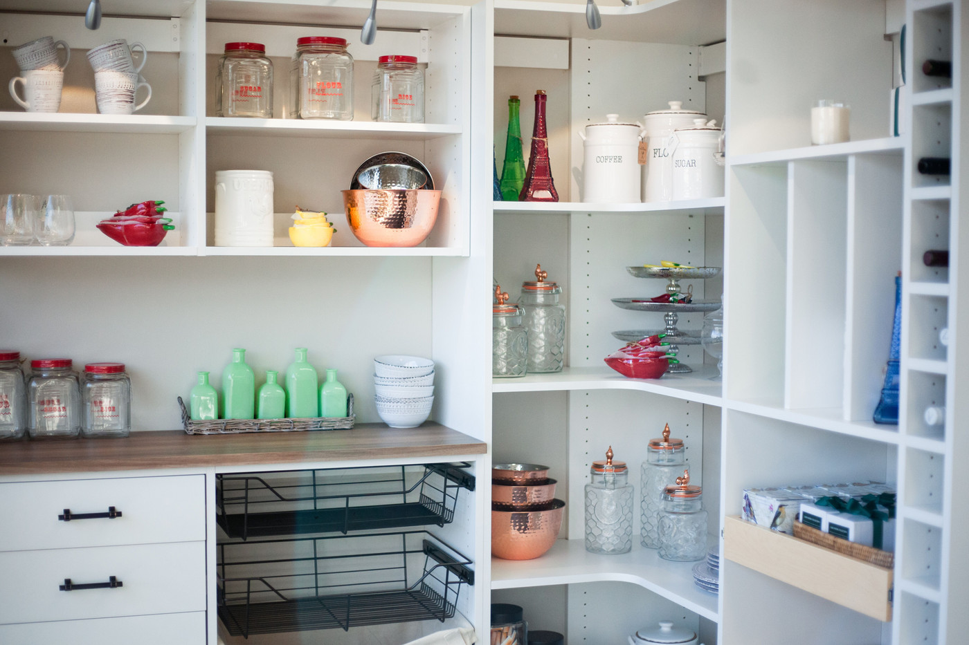 Pantry with pull-out drawers, wire baskets, and counter top from Closets by McKenry