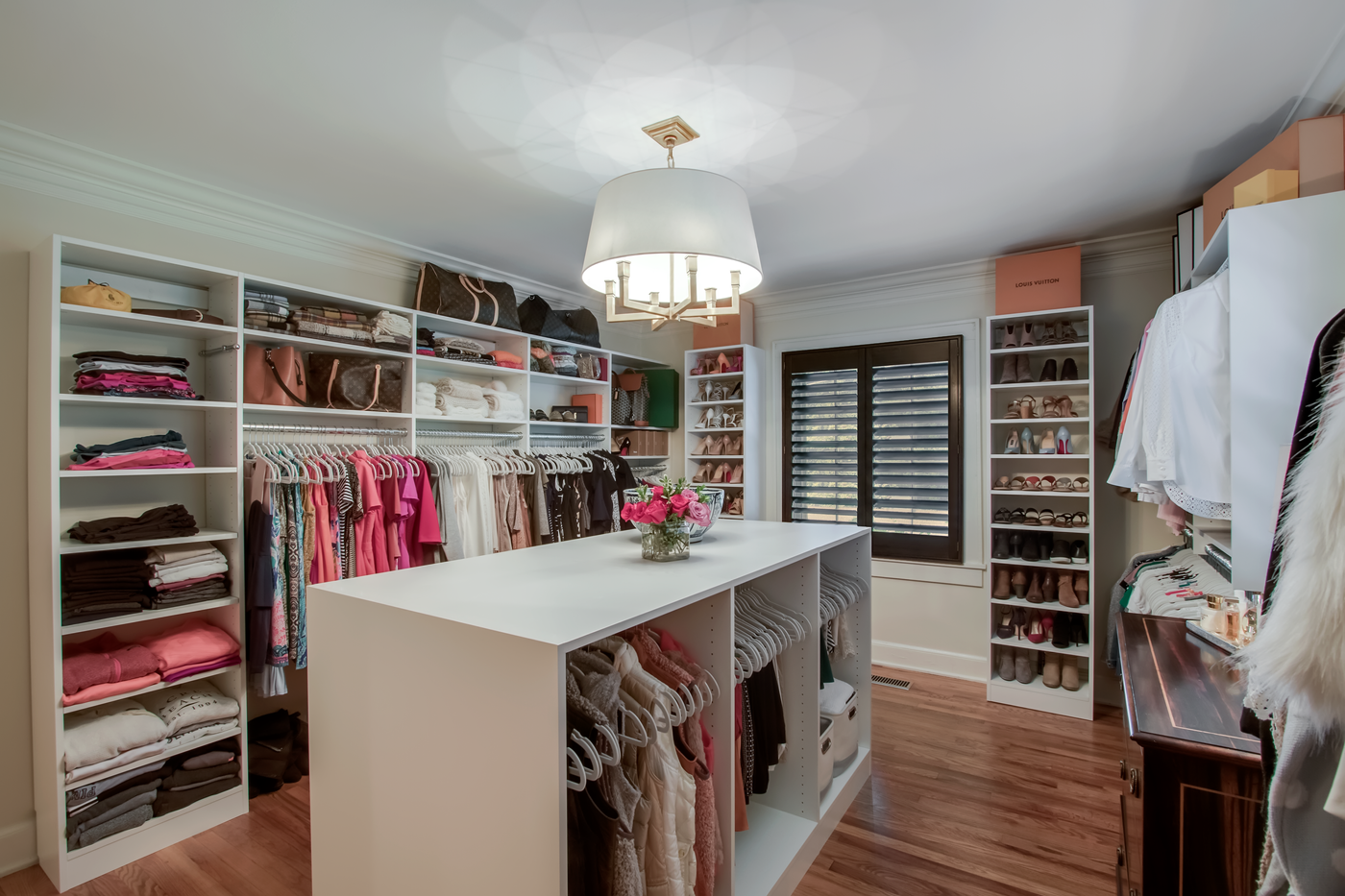 Glam Closet created in a room renovation from Closets by McKenry