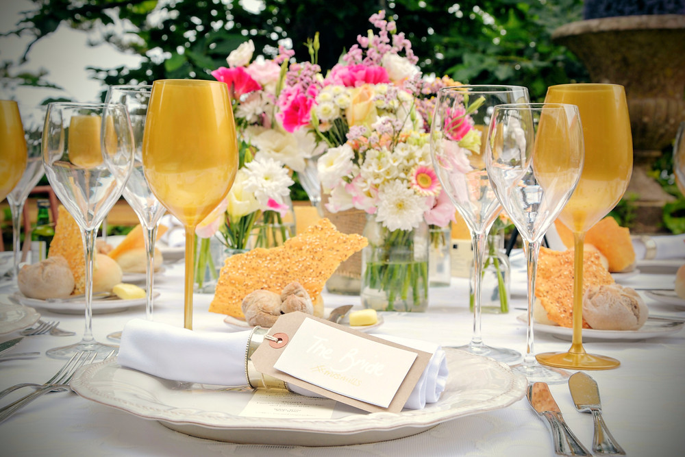 Beautiful round table setup with flowers, gold glasses, hand made name tags, at The Quinta My Vintage Wedding in Portugal