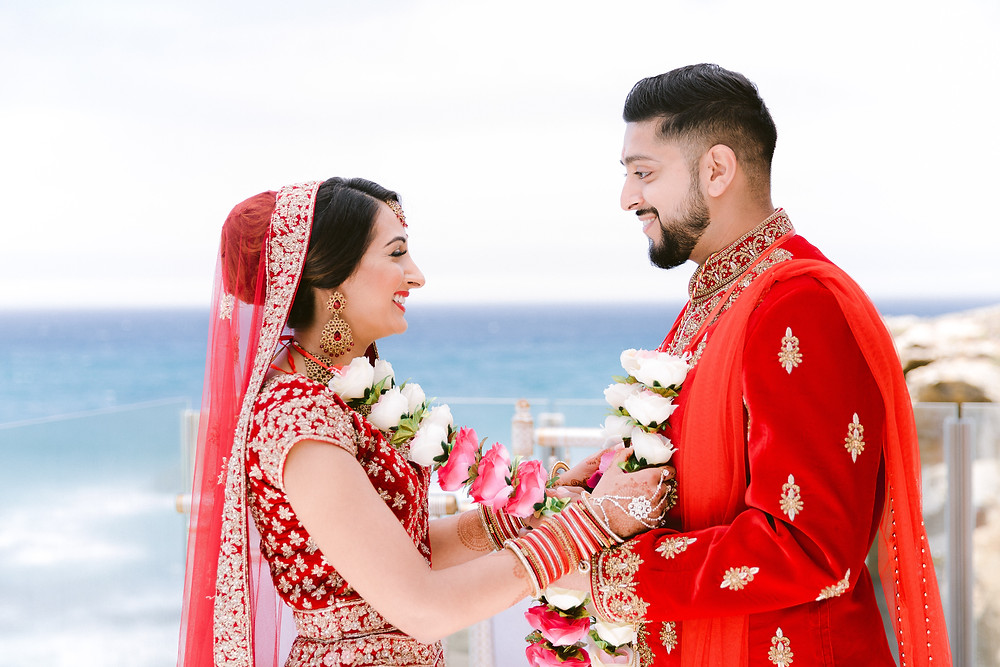 The Blue Sky and the Blue Ocean at Arriba by the Sea contrast against the Royal Red and Gold Outfits. Nital and Varun booked Arriba by the Sea for their Destination Wedding in Europe. The Real Wedding was featured with Wedding Sutra