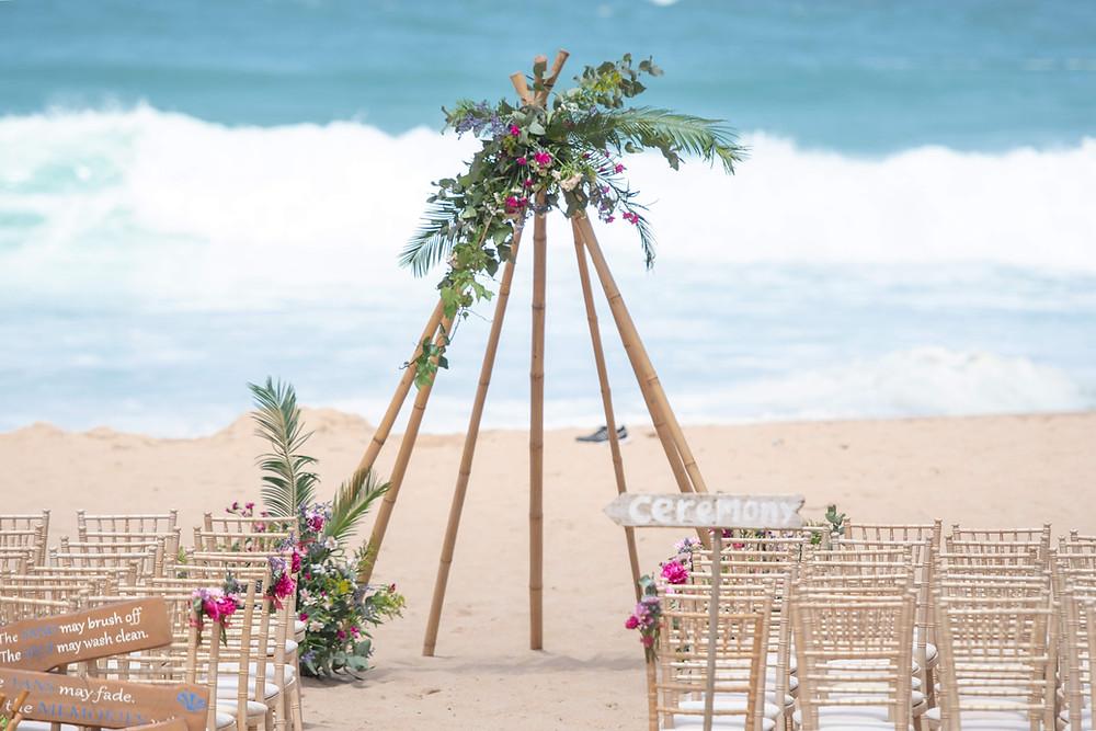 Tropical decoration for a beach wedding ceremony at Adraga Beach in Lisbon Coast Portugal