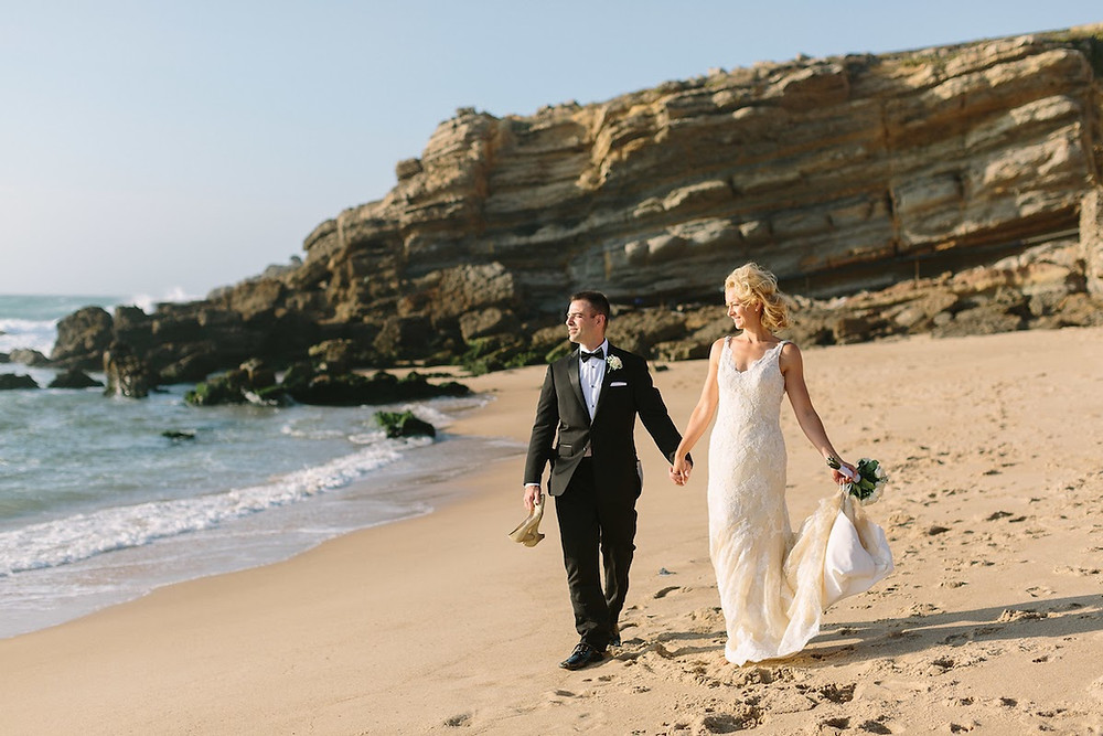 A couple after a beach wedding ceremony in Lisbon Portugal