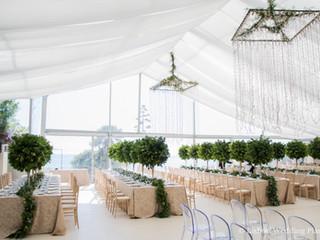 Longe table and greenery centrepiece at Forte da Cruz Beach Castle Wedding Venue in Estoril Portugal
