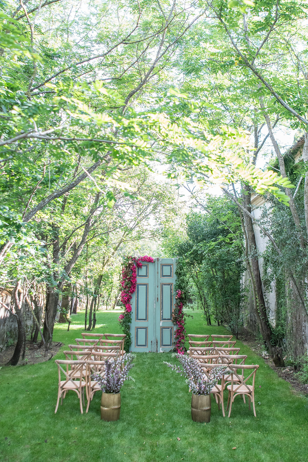 A wedding ceremony decoration style with crossback wood chairs