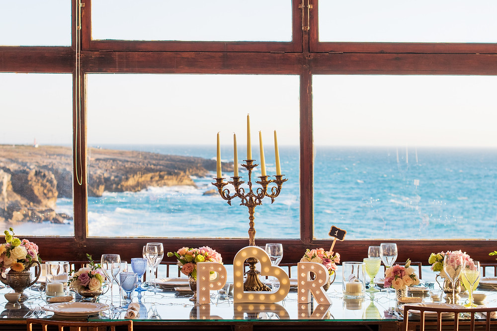 A vintage and rustic wedding reception in the panoramic beach view ballroom at Arriba by the sea
