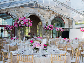 Forte da Cruz Wedding Reception with tall pink centrepieces in Portugal