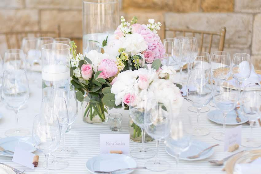 White and pink flowers tables setup with name tags