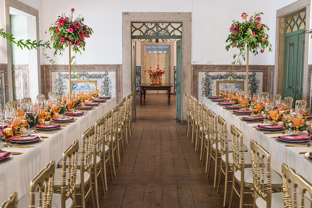 Pink and orange traveled theme wedding reception at the Noble room of Quinta do Torneiro