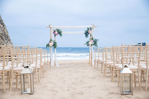 Beach Wedding Ceremony in Portugal with a Canopy with Flowers and white Fabrics