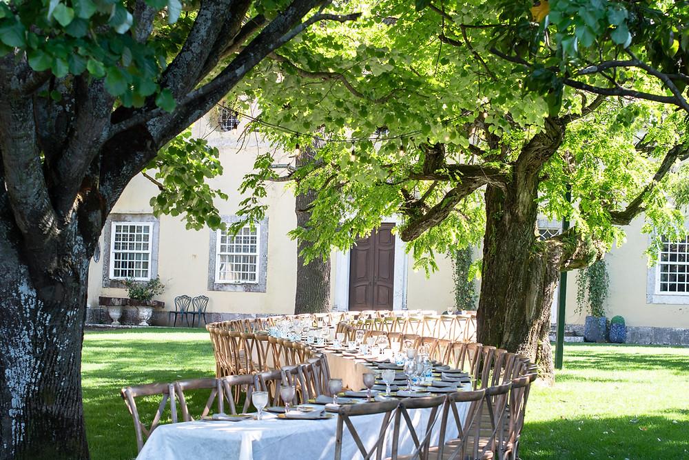 Outdoor garden wedding reception in a long table at Quinta do Torneiro