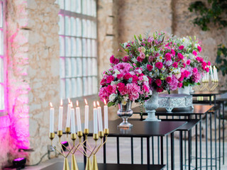 Candles and Pink flowers arragements at Forte da Cruz Greenhouse in Portugal
