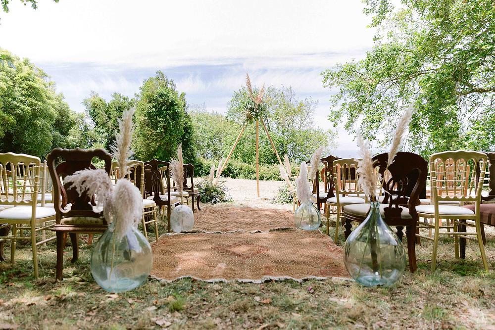 A boho wedding ceremony in the gardens of the Quinta My Vintage wedding venue Portugal