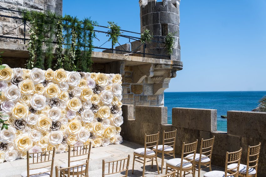 Lisbon Wedding Planner organized a Wedding ceremony decorated with colorful and elegant flower paper wall at Forte da Cruz in Estoril Portugal. The paper wall was the backdrop for the bride and groom.