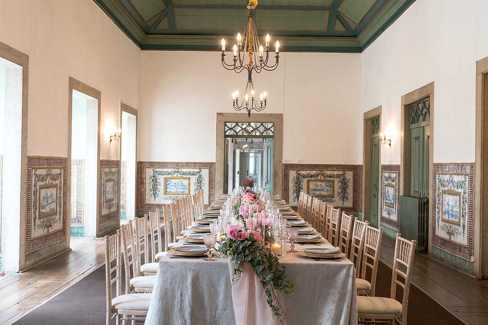 A wedding dinner for a mini wedding inside the Noble room at Quinta do Torneiro wedding venue