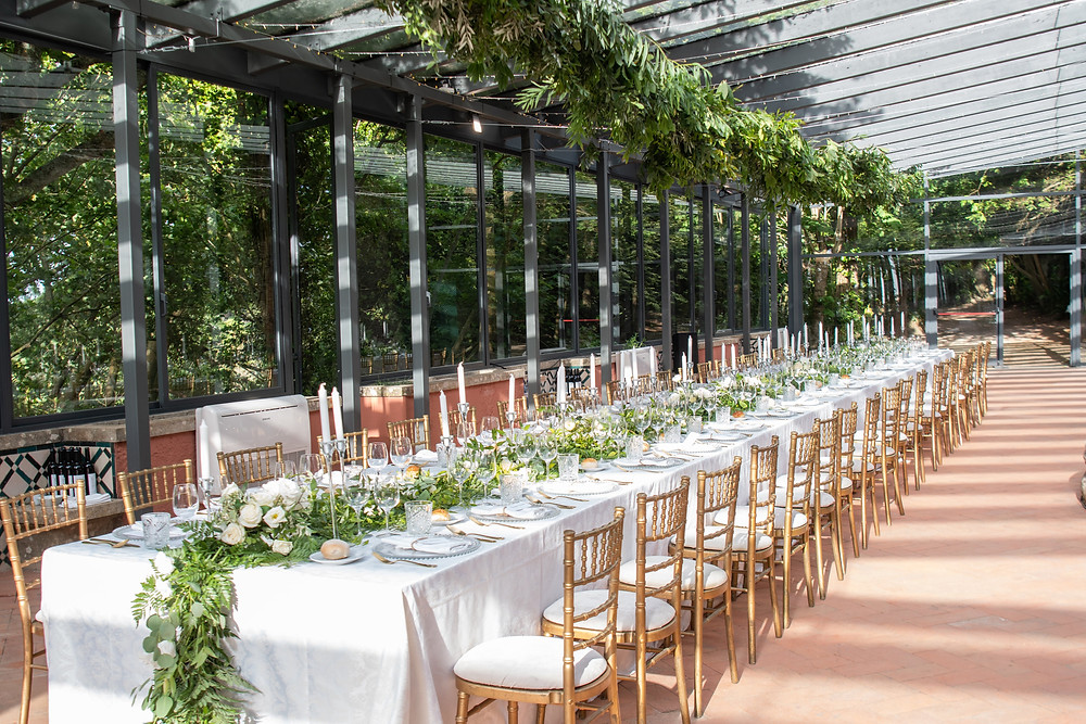 A long white table for a wedding reception in the castle Casa dos Penedos