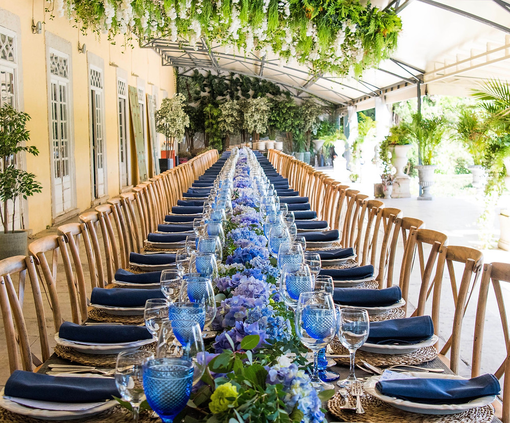 Wedding reception at Quinta do Torneiro venue with a long wood table and crossback chairs