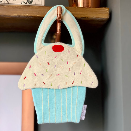 Baby bib in the shape of a blue cupcake Front View
