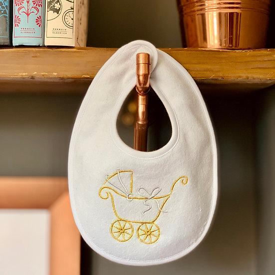 Newborn baby bib with a golden embroidered pram front view