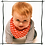 Cute baby crawling with red bandana bib
