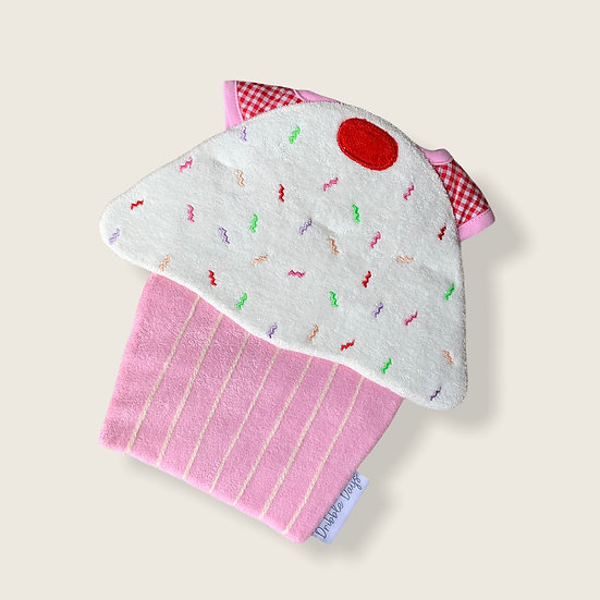 Baby bib in the shape of a pink cupcake cut out