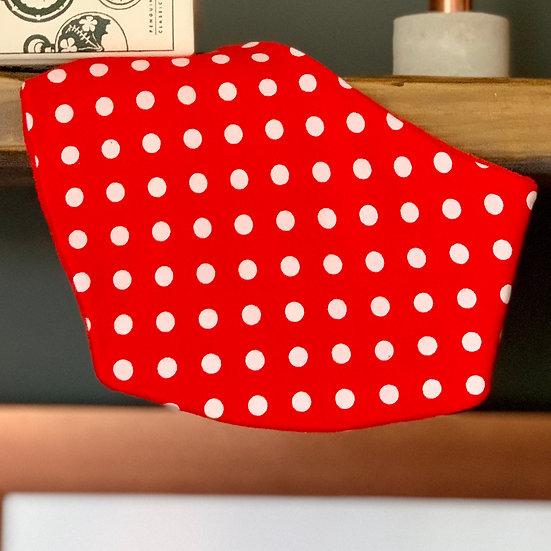 Red bandana baby bib with white polka dots front view