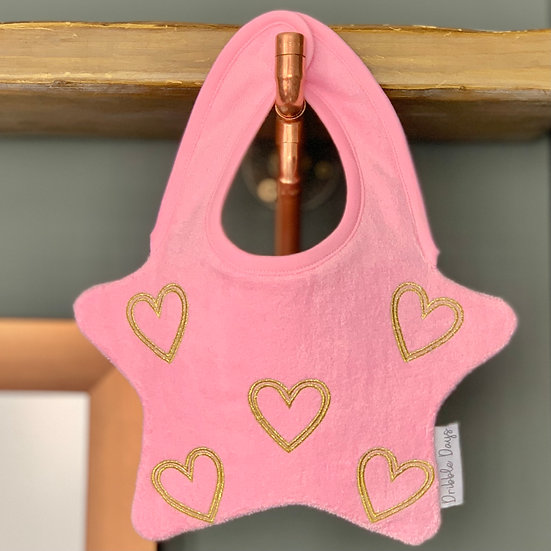 The Pink Heart Bib with embroidered golden hearts