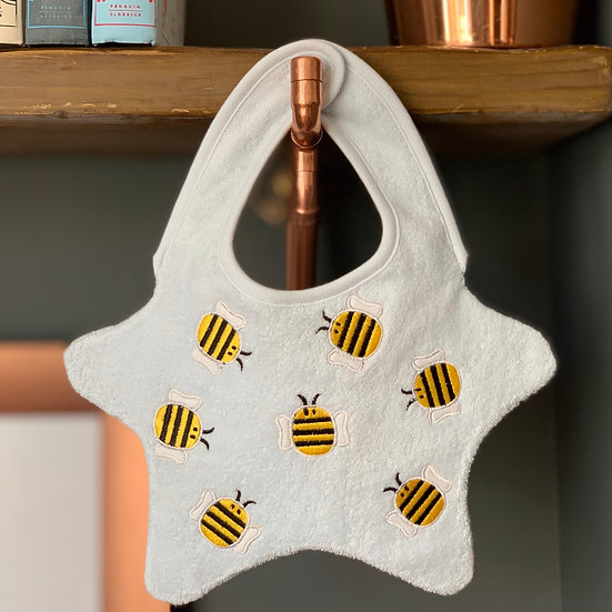 Blue baby bib with embroidered bumblebees front view