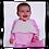 Baby laughing in a cupcake bib