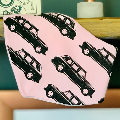 Pink bandana bib with london taxi print front view