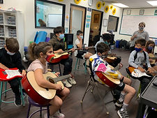 Students playing guitar.