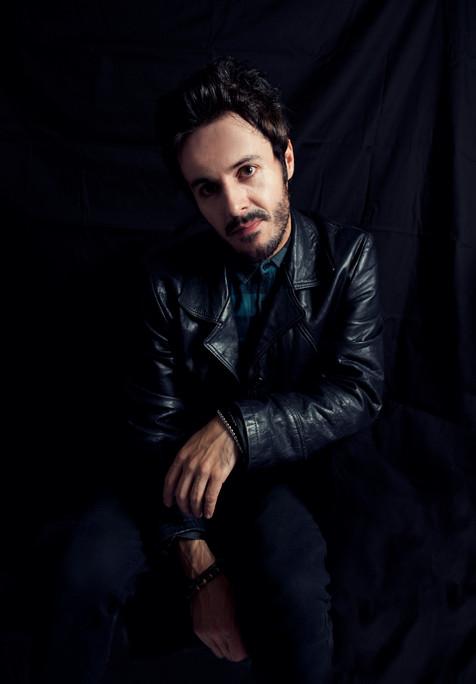James Kennedy, Singer, Songwriter, Producer, Kyshera, Konic Records,  UK, Wales, music, rock, band, alternative, leather, dark, sitting