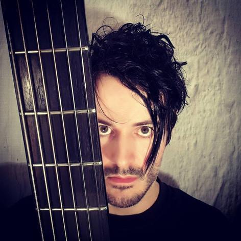 James Kennedy, Singer, Songwriter, Producer, Kyshera, Konic Records,  UK, Wales, music, rock, band, alternative, side fringe, hair, solo, acoustic, guitar