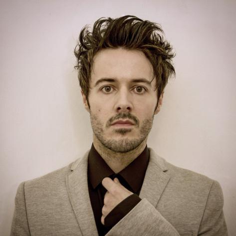 James Kennedy, Singer, Songwriter, Producer, Kyshera, Konic Records,  UK, Wales, music, rock, band, alternative, suit, hair, male,
