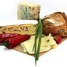 Assortiment of french and spanish cheeses with bread