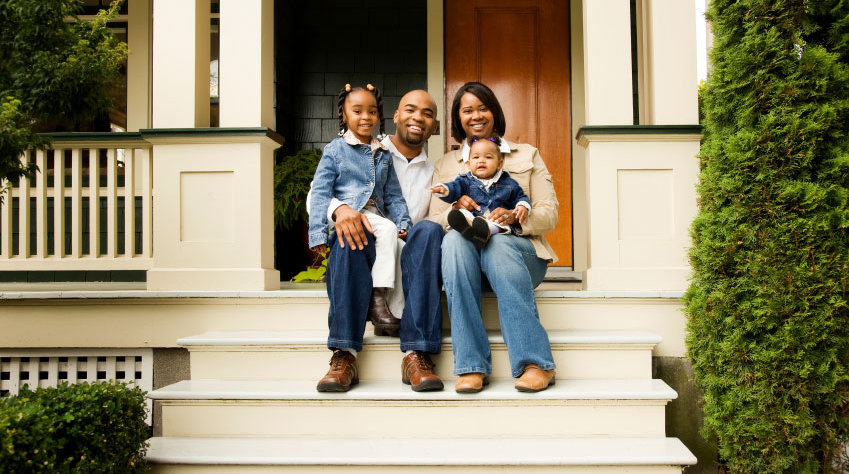 Black-family-sitting-on-front-porch-in-R