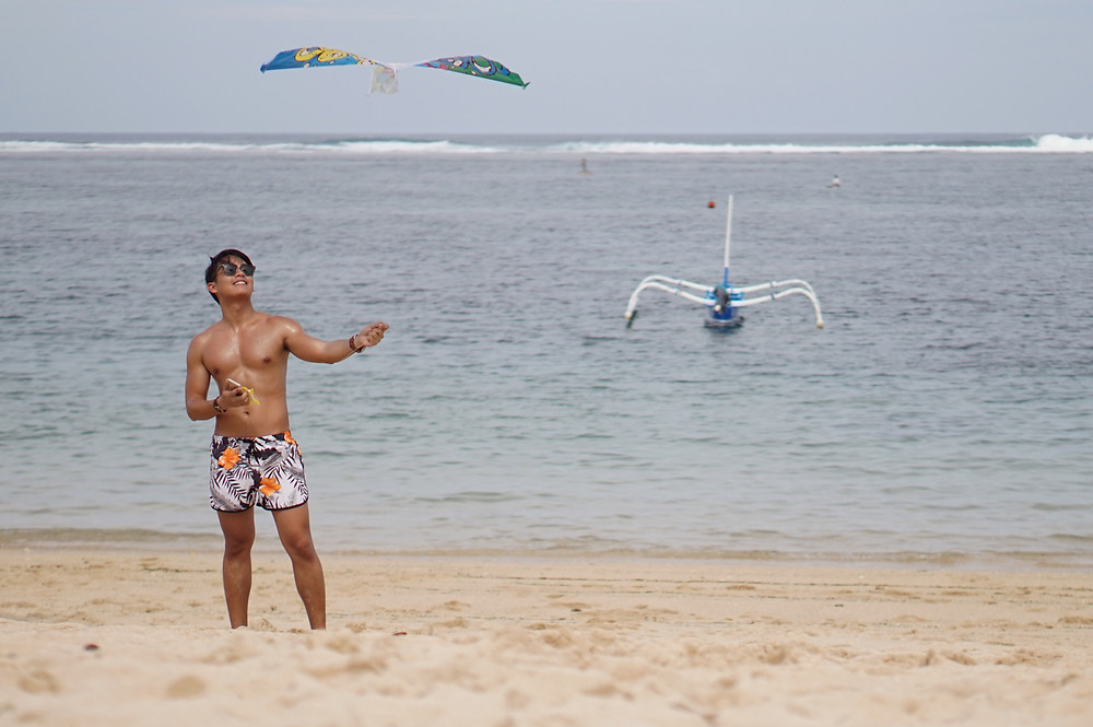 Flying a kite in Bali