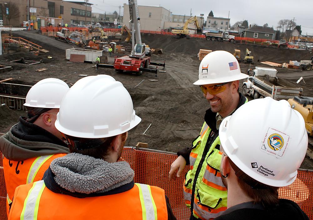 Construction supervisor with apprentices, Portland Oregon 2013