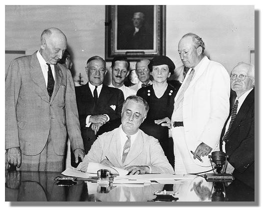 President Franklin Delano Roosevelt signing the Social Security law in 1935.